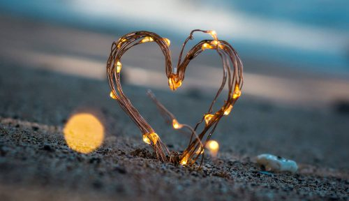 heart shaped with lights on the shore