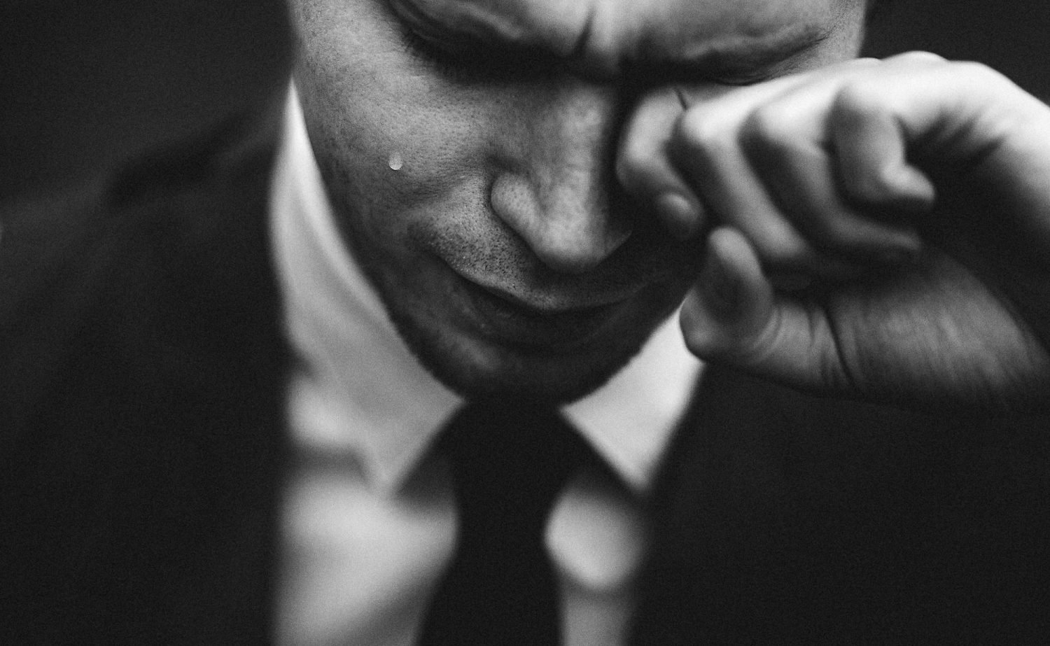 Man crying in business suit